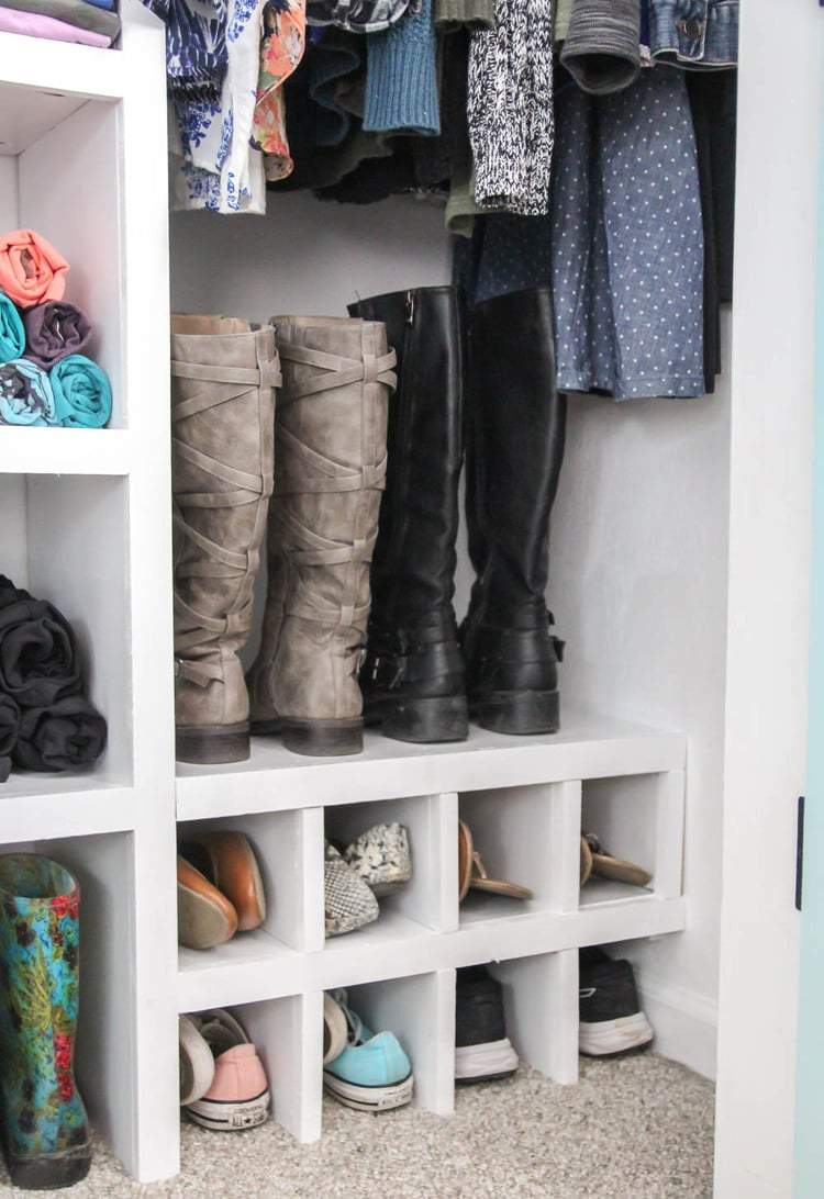 Shoe cubbies and shelves filled with shoes and boots.