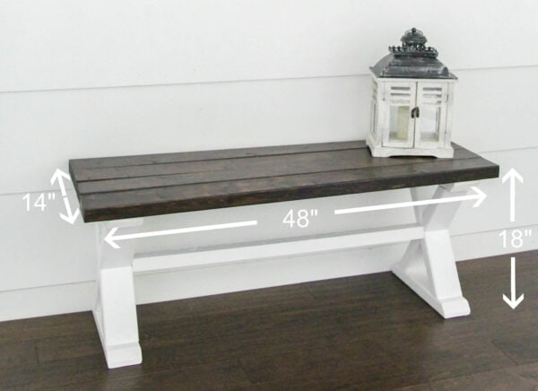diy wood bench with a dark wood top and white x legs with dimensions marked.