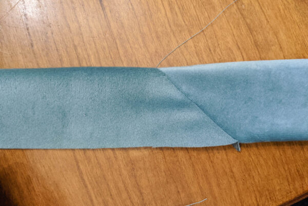 Long strip of fabric made by sewing two strips of fabric together on a diagonal.