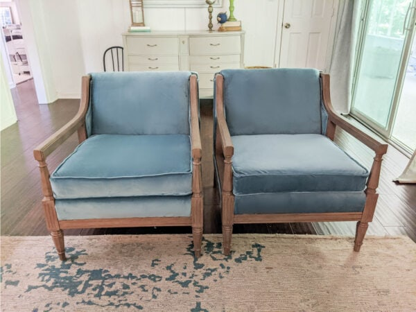 Pair of reupholstered chairs in living room.