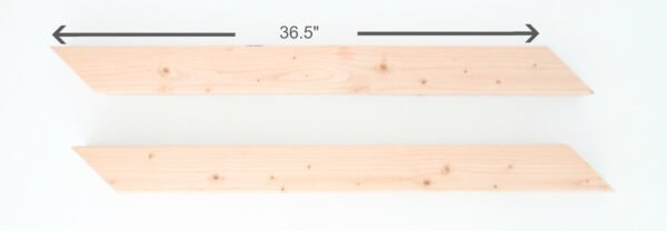 """Two 4""""x4"""" boards cut at 36.5"""" long with 45 degree parallel angled cuts."""
