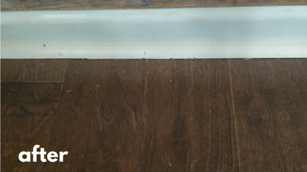 Engineered wood floor after repairing scratches.
