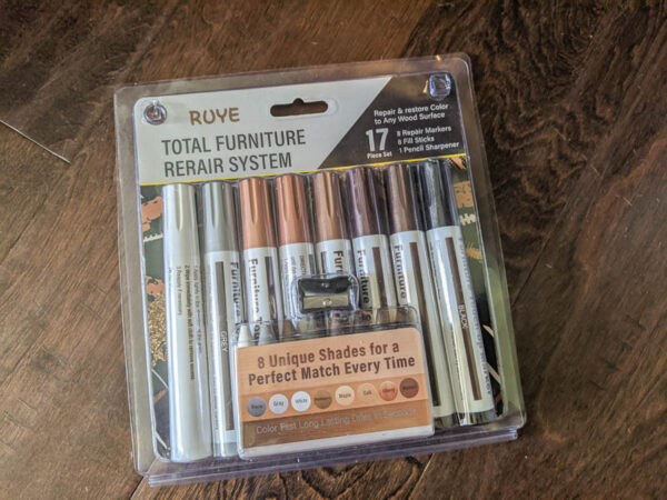 Wood repair kit with wood markers and wax fill sticks.