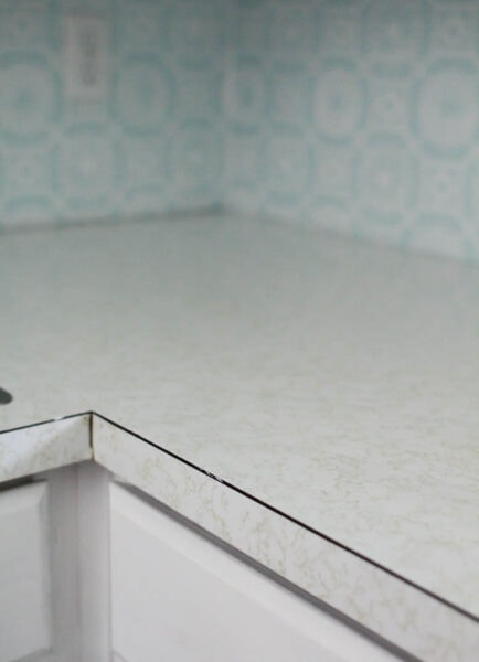 old laminate countertops - white with gold squiggles.