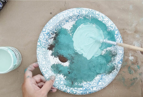Mixing paints to create a light blue-green patina color.